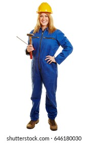 Woman as a construction worker with a helmet and tools