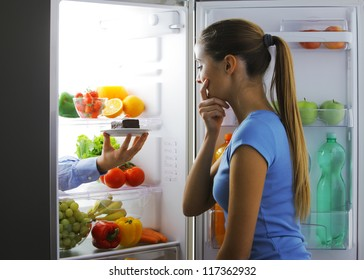 Woman contemplating if she should ruin her diet
