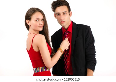 Woman in control of a man, sexy woman holding her man by his tie dominating him