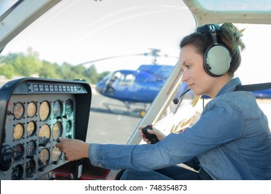 Woman at the controls of a helicopter