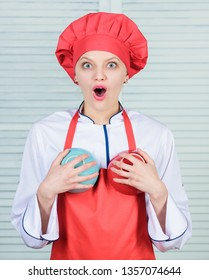 Woman cook hold bowls in front of breasts. Dreaming about bigger boobs. Diet play part in size of breasts. How increase breast size with food naturally and quickly. Eat these foods for bigger breasts.
