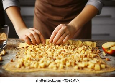 Woman cooking apple pie