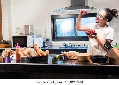 woman with cooking bread and Eating strawberries