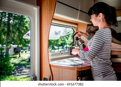 Woman cooking in camper, motorhome interior. Family vacation travel, holiday trip in motorhome, Caravan car Vacation.