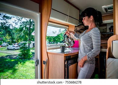 Woman cooking in camper, motorhome interior. Family vacation travel, holiday trip in motorhome RV, Caravan car Vacation.