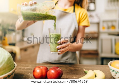 Woman cooking cocktail of fruit and vegetables