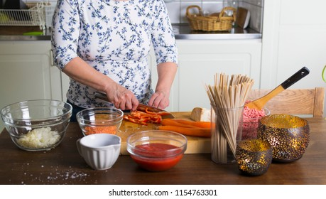 Woman cooking food at home