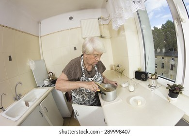 Woman cooking a pancakes at home. Close up