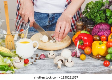 Woman cooks at the kitchen, soft focus background