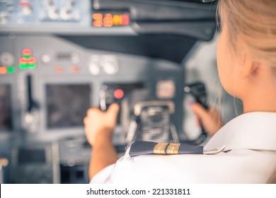 woman co-pilot having flight control