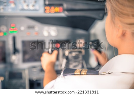 woman co-pilot having flight control