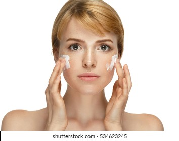 Woman cosmetic closeup beauty portrait with cream, for salon and advertisement beautiful people and healthy care skin and hair
