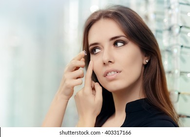 Woman with Cosmetic Colored Contact Lens in Optical Store - Close up of a girl trying on beauty medical contact lenses