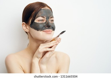 woman in a cosmetic mask