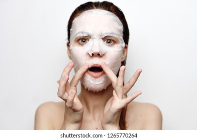 woman in cosmetic mask care