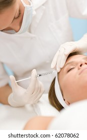 Woman in cosmetic medicine treatment getting an injection, close-up portrait