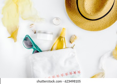 Woman cosmetic set with sun protection lotion white background top view