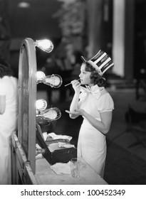 Woman in costume applying makeup