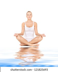 woman in cotton undrewear practicing yoga lotus pose on white sand