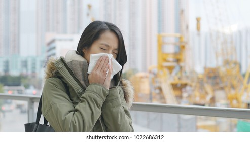 Woman cough at outdoor with air pollution in the city