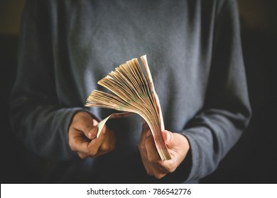 Woman counting cash money , Stack of Money in hand , business and income concept , Vintage tone effect.