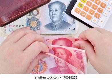 Woman counting Chinese yuan banknotes.Chinese yuan banknotesin hands