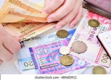 Woman counting Hong Kong dollar banknotes