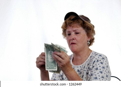 A woman counts her money
