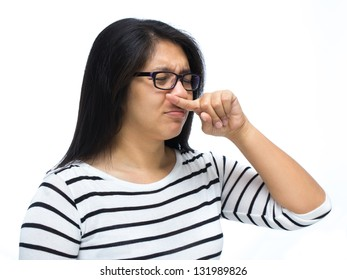 Woman cover her nose caused by bad smell