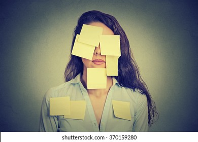 Woman covered in yellow notes