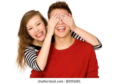 Woman covering boyfriend's eyes