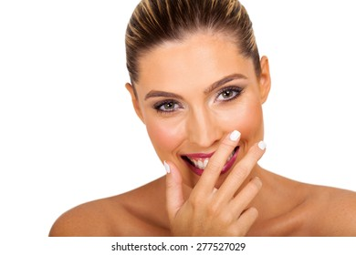 woman covering her mouth and laughing isolated on white background