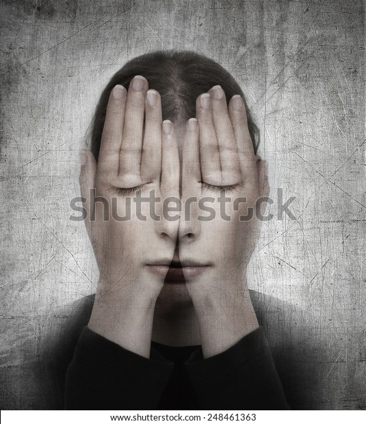 Woman covers her face with her hands. Surreal concept photo manipulation.