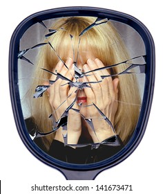 A woman covers her face reflected in a  broken mirror or the shattered life concept