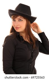 woman with a cowboy's, man's hat on a white background it is isolated