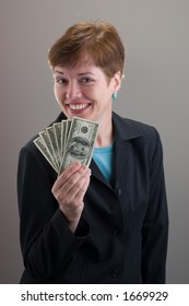 woman with coy smile and cash in hand