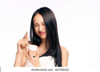 Woman with cream, facial treatment