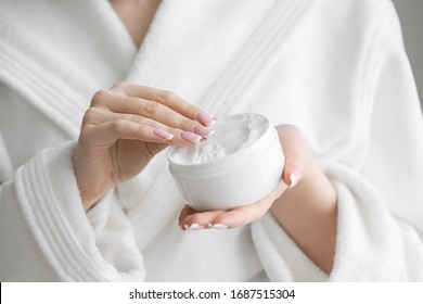 Woman cream hand apply face cosmetic concept