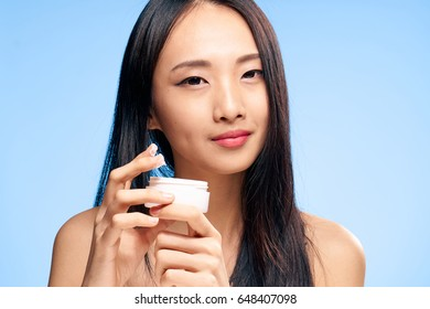 Woman with cream on a blue background