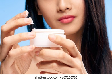 Woman with cream, skin care