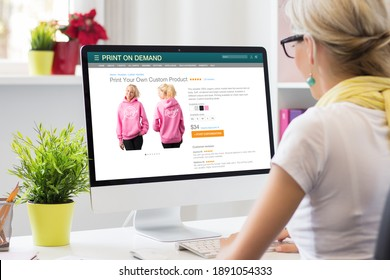 Woman creating her own products by using print on demand service online