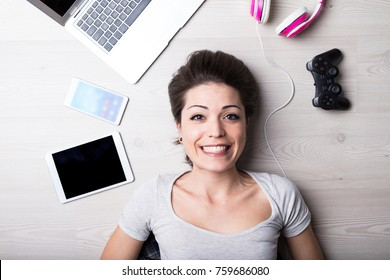 woman with creative entertainment tools for her time off, to write read surf play or listen some music