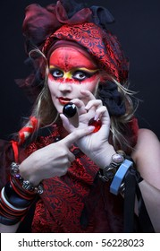 Woman with creative make-up  with strass in her hands