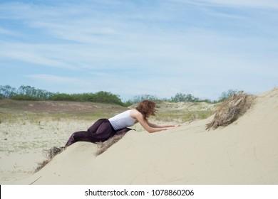 Woman creeps up a mountain