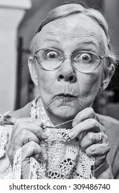 Woman with crochet and funny facial expression