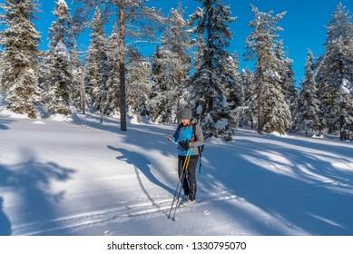 Woman cross country skiing