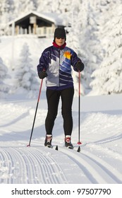Woman cross country skiing on a sunny winter morning