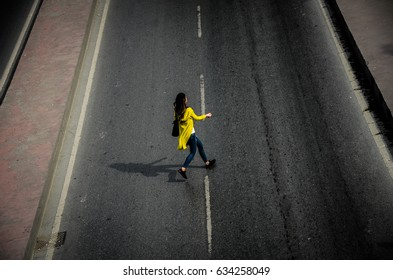 Woman cross a street