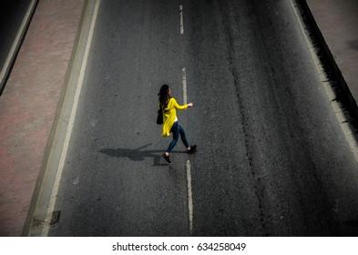 Woman cross a street