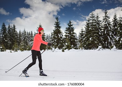 A woman cross-country skiing in the Alps